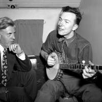 Soaring: Henry A. Wallace listens to Pete Seeger on a plane between Norfolk and Richmond, Virginia, in August 1948. | AP