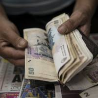 Argentina relaxes controls on U.S. dollar purchases
