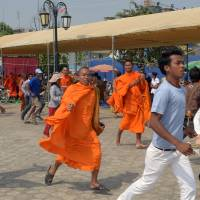 Cambodian riot police disperse opposition camp