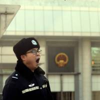 China activist's four-year prison term sparks criticism