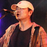 Cui Jian at the 2007 Hohaiyan Gongliau Rock Festival. | 楊公/FLICKR/WIKIMEDIA COMMONS