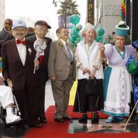 Only one left: Munchkins from 'The Wizard of Oz' pose as they are honored with a star on the Hollywood Walk of Fame at Grauman's Chinese Theatre, site of the film's 1939 premiere, in Los Angeles on Nov. 20, 2007. The Munchkin cast members, from left: Clarence Swensen, a Munchkin soldier; Jerry Maren, part of the Lollipop Guild; Mickey Carroll, the town crier; Karl Slover, the main trumpeter; Ruth Duccini, a Munchkin villager; Margaret Pelligrini, the 'sleepyhead' Munchkin; and Meinhardt Raabe, the coroner. | AP