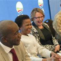 ANC counterbalance: (From left) Musa Maimane, Mamphela Ramphele, Helen Zille and Wilmot James share a joke Tuesday at a Cape Town press conference where Ramphele, leader of the Agang party, was announced  as the Democratic Alliance's presidential candidate for this year's South African elections. | AFP-JIJI