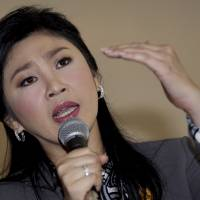 Precarious position: Thai Prime Minister Yingluck Shinawatra answers questions during an interview with foreign media on the outskirts of Bangkok on Friday. | AP