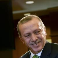Laughing matter?: Turkey's Prime Minister Recep Tayyip Erdogan gives a press conference after a meeting at the European Parliament in Brussels on Tuesday. | AFP