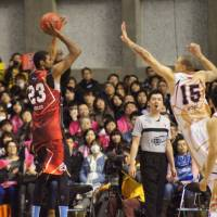 Shooter's touch: West All-Star Edwin Ubiles of Kyoto takes a jump shot as the East's Richard Roby of Akita defends him. Ubiles scored a game-high 27 points in the West's 99-91 loss to the East at Akita Municipal Gymnasium. | TAKASHI SATO
