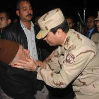 Man to man: Defense Minister Gen. | ABDEL-FATTAH EL-SISSI CONSOLES A MAN AT A FUNERAL FOR SEVERAL MILITARY PERSONNEL KILLED WHEN A HELICOPTER CRASHED ON THE SINAI PENINSULA AT AN UNDISCLOSED LOCATION IN EGYPT.EGYPTIAN DEFENSE MINISTRY/AP