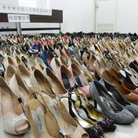 Well-heeled?: Pairs of high heels confiscated from the dwelling of alleged thief Sho Sato, 28, are shown to the media Wednesday at the Metropolitan Police Department's Ikebukuro Police Station. | KYODO