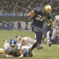 Getting the job done: Running back Takuto Hara of the Obic Seagulls rushes for 114 yards and two touchdowns in his team's 34-16 win in the Rice Bowl over Kwansei Gakuin University on Friday at Tokyo Dome. Hara was named the game's MVP. | KYODO