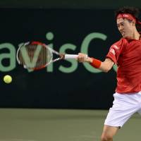 Leader of the pack: Kei Nishikori plays a shot during his straight-sets win over Canada's Peter Polansky on the first day of their Davis Cup tie at Ariake Coliseum on Friday. | AFP-JIJI