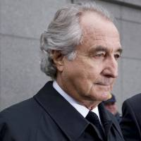 Mastermind: Bernard Madoff is led out from Federal court on Mar. 10, 2009, in New York. | BLOOMBERG