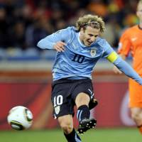 Too hot to handle: Uruguay's Diego Forlan shoots during the 2010 World Cup semifinal against the Netherlands. Forlan is reportedly on the brink of signing with Cerezo Osaka. | KYODO