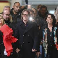 Double jeopardy?: Raffaele Sollecito (center), the former Italian boyfriend of Amanda Knox, leaves a court Thursday in Florence, Italy, after attending the final hearing that overturned their acquittals for the murder of British student Meredith Kercher. | AP