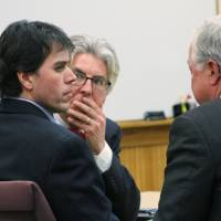 Road rage: Defense attorneys Charles Groh (center) and Douglas Mullkoff (right) speak to Raulie Wayne Casteel after a jury convicted Casteel, 44, of Wixom, Michigan, of terrorism for shooting at motorists on a busy highway and on other charges. | AP