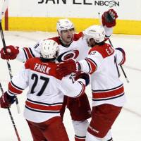 Eye of the storm: Jiri Tlusty (center) celebrates with his Hurricanes teammates after scoring in a 3-2 win over the Flyers on Wednesday. | AP