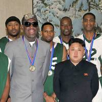 Jumping through hoops: A Wednesday photo released by North Korea's official Korean Central News Agency on Thursday shows Pyongyang leader Kim Jong Un with former U.S. basketball star Dennis Rodman (front left) and other ex-NBA players at Pyongyang Gymnasium. | AFP-JIJI