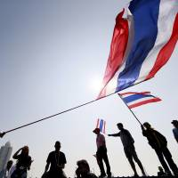 Starter's orders: Anti-government protesters attend a warm-up rally Thursday for their plan to paralyze Bangkok on Monday, in a bid to topple the government of Prime Minister Yingluck Shinawatra. | AP