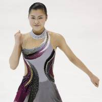 Top of the charts: Kanako Murakami performs her short program at the Four Continents on Thursday in Taipei. Murakami leads the event heading into the free skate. | KYODO
