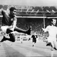 Full swing: Portuguese legend Eusebio shoots while playing for Benfica against AC Milan in the 1963 European Cup final at Wembley. | AFP-JIJI
