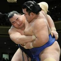 Nearly man: Kakuryu (left) finished with a 14-1 record at the New Year Grand Sumo Tournament but lost the championship playoff to yokozuna Hakuho. | KYODO
