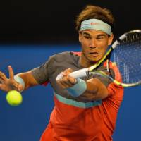 Title quest continues: Rafael Nadal hits a return against Roger Federer in the Australian Open semifinals on Friday. Nadal defeated Federer in three straight sets. | AFP-JIJI