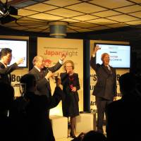 From right: Klaus Schwab, founder of the WEF, Schwab's wife, Hilde, Yorihiko Kojima, chairman of the board of Mitsubishi Corp., and William H. Saito, CEO of InTecur, make a toast at the Japan Night event in Davos during the WEF in 2013. | WILLIAM H. SAITO