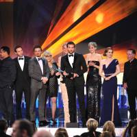 Cleaning up nice: Bradley Cooper accepts a Screen Actors Guild Award on behalf of the cast of 'American Hustle' last week. | AP