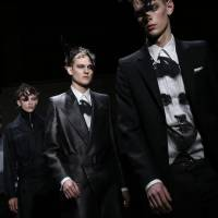 The Alexander McQueen runway show at the London Collections: Men autumn-winter 2014 event showcased slick suits and graphic patterns in blacks and grays. | AP
