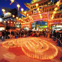 All lit up: Lanterns and candles illuminate Yokohama's Ma Zhu Miao Temple.