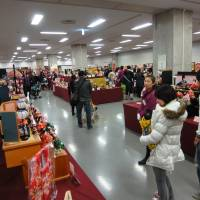 It's a small world: Visitors admire Hinamatsuri figurine sets at the Pacifico Yokokama Doll Exhibition