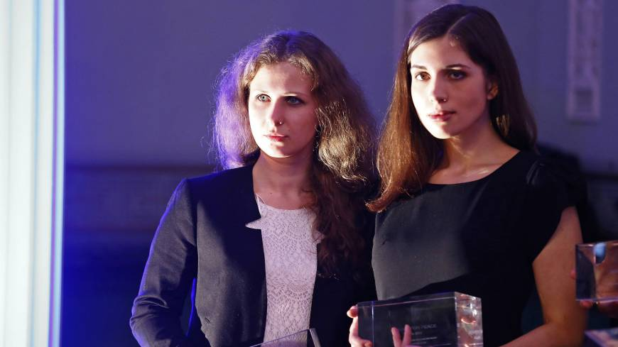 Russian punk band Pussy Riot members Maria Alyokhina (left) and Nadezhda Tolokonnikova pose after winning an award in the category 'Most Valuable Documentary of the Year' at the 'Cinema for Peace' charity gala in Berlin on Feb. 10.