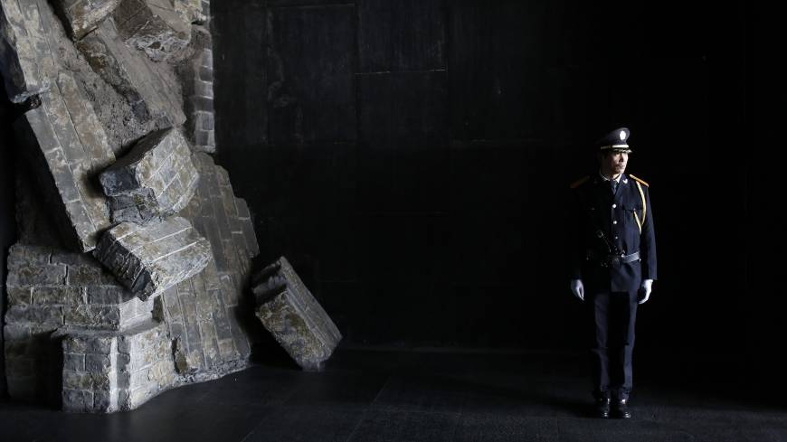 A security guard stands guard inside the Memorial Hall at the Nanjing Massacre Museum in Nanjing, Jiangsu Province. China wants to make World War II a key part of a trip by President Xi Jinping to Germany next month, much to Berlin's discomfort.