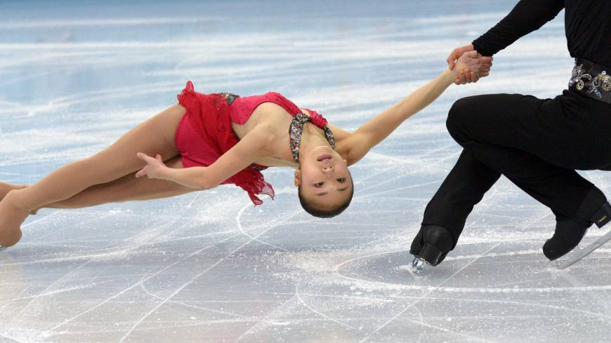 Japan's Ryuichi Kihara and Narumi Takahashi skate toward an 8th place finish in the short program of the figure skaing pairs team competition of the Sochi Winter Olympics.