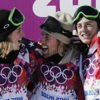U.S. snowboarder Sage Kotsenburg, center, celebrates with  Norway's Staale Sandbech, left, and Canada's Mark McMorris after Kotsenburg took the gold medal in the men's  snowboard slopestyle final at the Rosa Khutor Extreme Park, at the 2014 Winter Olympics, in Krasnaya Polyana. Sandbech took the silver medal and McMorris took bronze.  | AP