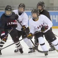 Japan's women's hockey team, making its first appearance at the Olympics since the 1998 Nagano Games, practice Saturday morning before its opening game against Sweden on Sunday. | KYODO