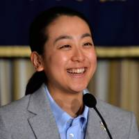 Figure skater Mao Asada smiles during a press conference held on Tuesday at the Foreign Correspondents' Club of Japan in Tokyo. | AFP-JIJI