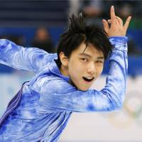 Hanyu halfway to Olympic gold