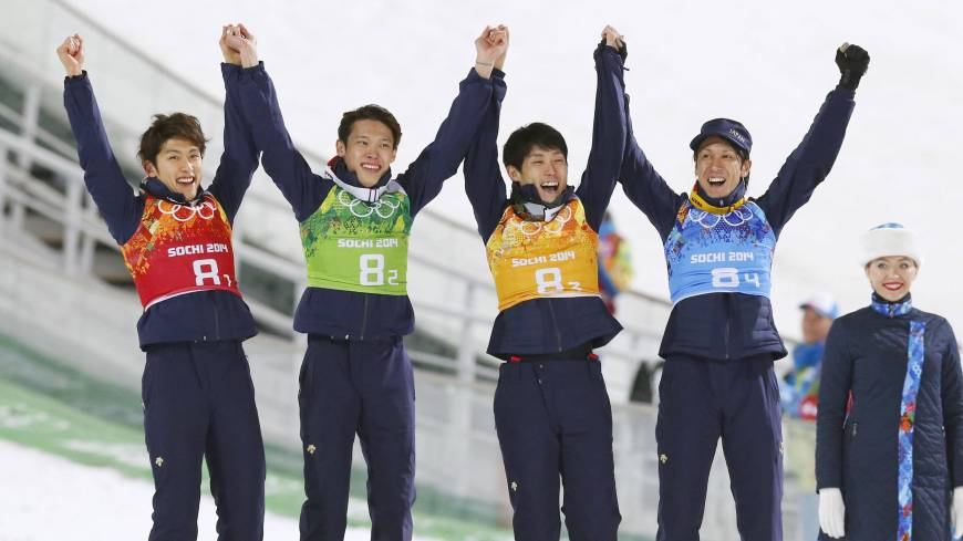 Japanese jumpers (from left) Reruhi Shimizu, Taku Takeuchi, Daiki Ito, Noriaki Kasai celebrate after earning the bronze in the ski jumping large hill team event at the 2014 Winter Olympics on Monday in Krasnaya Polyana, Russia.