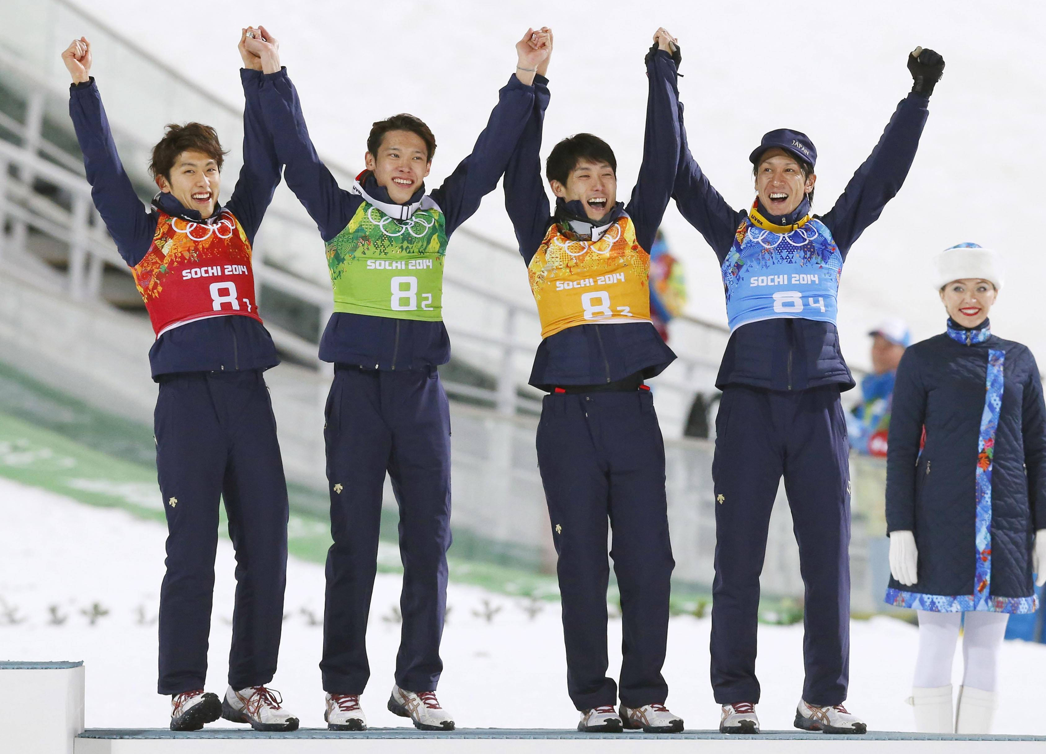 Japanese jumpers (from left) Reruhi Shimizu, Taku Takeuchi, Daiki Ito, Noriaki Kasai celebrate after earning the bronze in the ski jumping large hill team event at the 2014 Winter Olympics on Monday in Krasnaya Polyana, Russia.  | KYODO