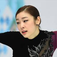 Defending champion Yuna Kim  of South Korea performs her free skate in the women's figure skating event on Thursday.  Kim scored 144.19 and settled for silver. | AFP-JIJI