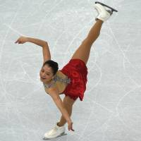 Japan's Akiko Suzuki performs in the Women's Figure Skating Short Program at the Iceberg Skating Palace during the Sochi Winter Olympics on February 19, 2014. | AFP-JIJI