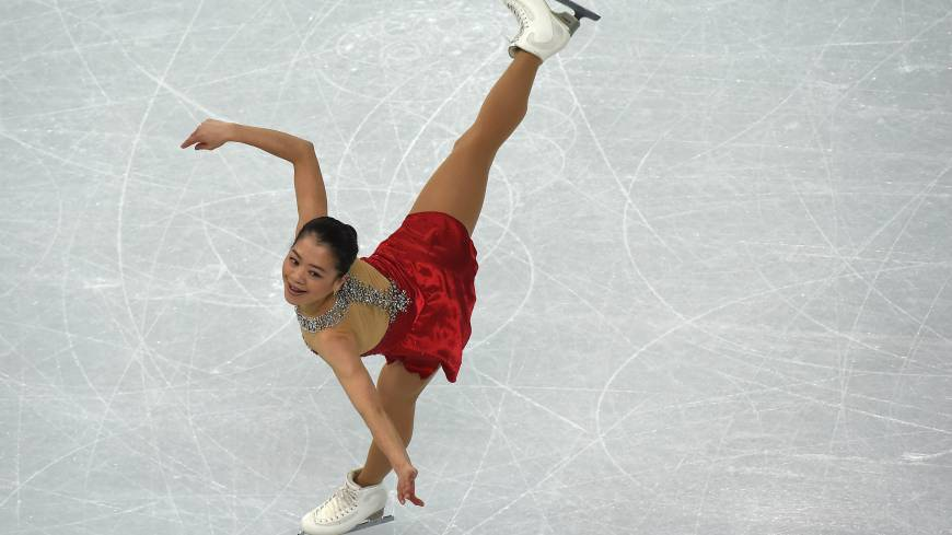 Japan's Akiko Suzuki performs in the Women's Figure Skating Short Program at the Iceberg Skating Palace during the Sochi Winter Olympics on February 19, 2014.
