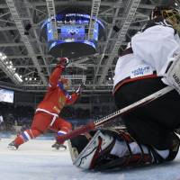 Forward Yekaterina Pashkevich celebrates after Russia's Alexandra Vafina managed to get the puck past goaltender Nana Fujimoto in the final minutes of a preliminary-round game at Shayba Arena on Tuesday night.  | AFP-JIJI