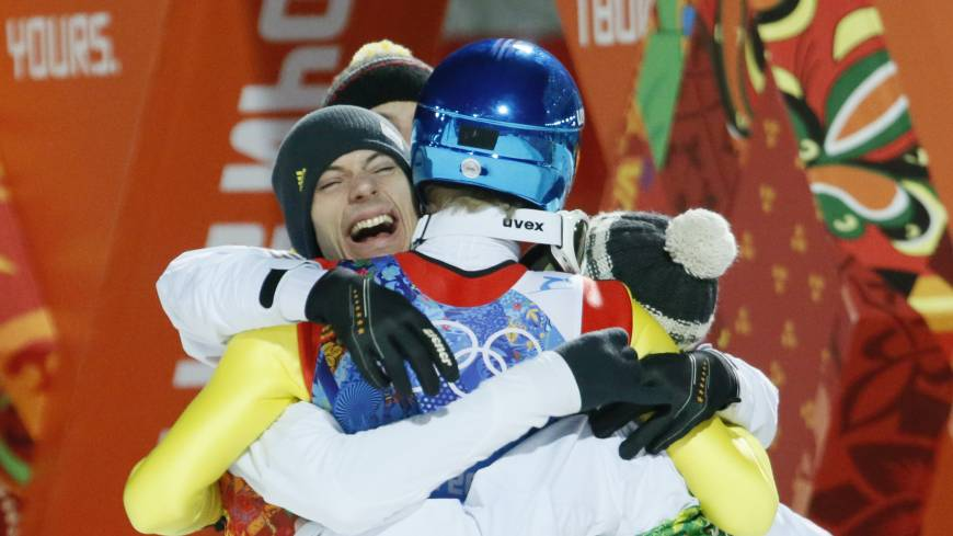 Germany's Andreas Wank (left) celebrates with his teammates after winning the gold in the ski jumping large hill team event at the 2014 Winter Olympics on Monday in Krasnaya Polyana, Russia.