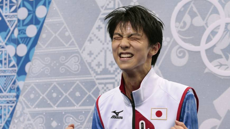 Yuzuru Hanyu of Japan reacts after receiving a high score for his short program.