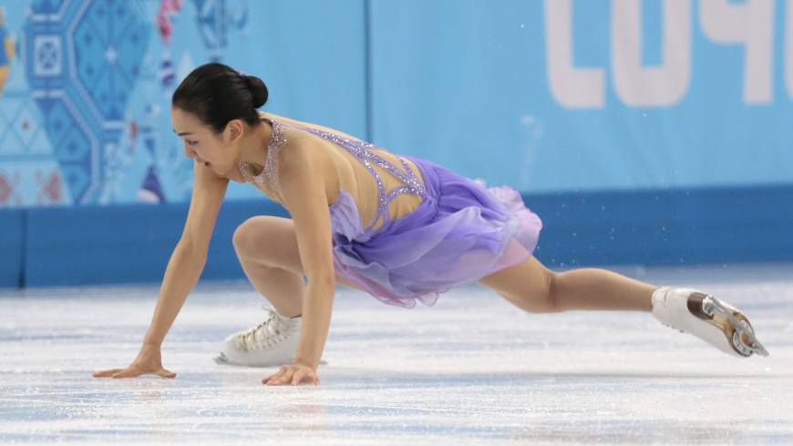 Mao Asada of Japan falls after attempting a triple axel in her short program on Wednesday. She posted 55.51 and is in 16th place.
