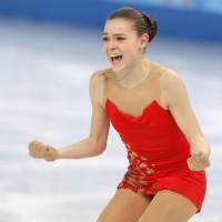 Adelina Sotnikova of Russia reacts after completing her short program in the women's figure skating competition on Wednesday. She earned 74.64 points and stands in second place behind Kim heading into Thursday's free skate.   AP