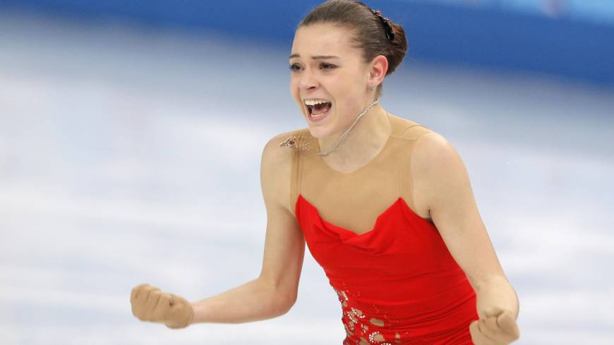 Adelina Sotnikova of Russia reacts after completing her short program in the women's figure skating competition on Wednesday. She earned 74.64 points and stands in second place behind Kim heading into Thursday's free skate.