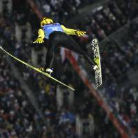 Japan's Noriaki Kasai makes an attempt during the ski jumping large hill team event at the 2014 Winter Olympics on Monday in Krasnaya Polyana, Russia.  | AP