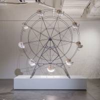 Masato Kodama's 'Nautilus propeller (Ferris wheel)' is propelled by solar -powered fans attached to the bottom of each of the nautilus shells.